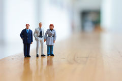 Some busines people on stage. The businesof figure people on stage Royalty Free Stock Images
