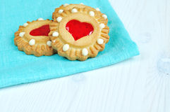 Some butter shortbread cookies stuffed with red heart shaped jelly - romantic background with free space for text. Romantic meal concept - three butter royalty free stock photo