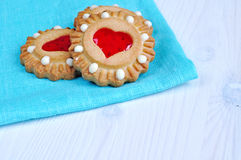 Some butter shortbread cookies stuffed with red heart shaped jelly - romantic background Stock Photo