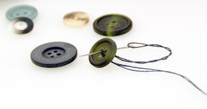 Some buttons and needle. Isolated Royalty Free Stock Image