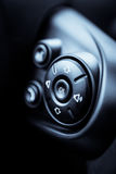 Some buttons on steering wheel. Detail on some buttons on a steering wheel stock photo