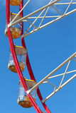 Some cabins at Ferris Wheel. At the blue sky background stock images