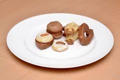 Some cakes on a plate. The some cakes on a plate Royalty Free Stock Image