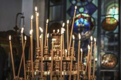 Candle sticks in a church. Some candle sticks in a church Royalty Free Stock Photography