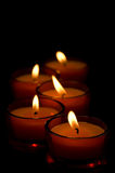 Some candles. On black background Royalty Free Stock Images