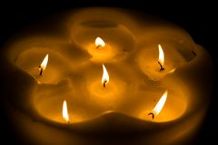 Some candles. Some nice candles illuminating the dark room Royalty Free Stock Image