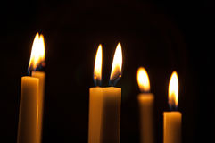 Some candles in the dark. Some white candle burning in the dark in Cathedral Stock Image