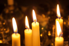 Some candles in the dark. Some white candle burning in the dark in Christmas time Royalty Free Stock Image