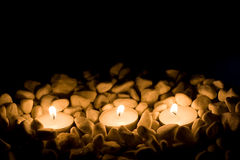 Some candles with stones. On black background Royalty Free Stock Photos