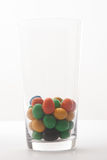 Some candy in a glass. On table stock images
