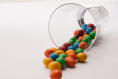 Some candy in a glass. On table stock photography