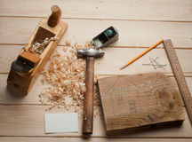 Some carpenter tools on wooden box. Close up stock images