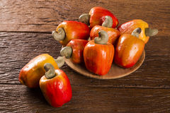 Some cashew fruit over a wooden surface. Some cashew fruit over a wooden surface Royalty Free Stock Image