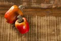 Some cashew fruit over a wooden surface. Some cashew fruit over a wooden surface Stock Photos