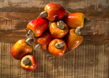 Some cashew fruit over a wooden surface. Some cashew fruit over a wooden surface Stock Photo