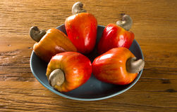Some cashew fruit over a wooden surface. Some cashew fruit over a wooden surface Stock Images