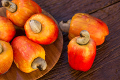 Some cashew fruit over a wooden surface. Some cashew fruit over a wooden surface Royalty Free Stock Images