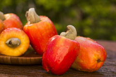 Some cashew fruit over a wooden surface. Fresh fruit Stock Photo