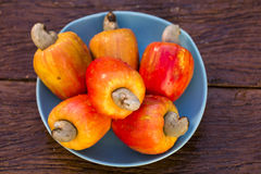 Some cashew fruit over a wooden surface. Fresh fruit stock images