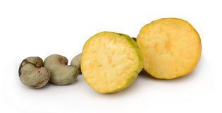 Some cashews with leafs. On a white background Stock Photography