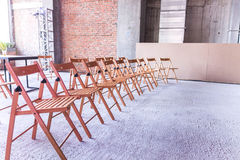 Some chairs. Several seats. Seminar. Lecture. Work place for workers in build royalty free stock photos
