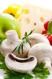 Some champignon,green parsley,rosemary vegetables. Some fresh champignon,cheese,apple,fresh vegetables with green leaves of parsley,rosemary stock image