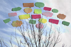 Some comic balloons and branches. Background Stock Photography