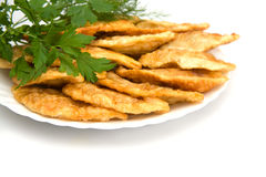 Some chebureks with parsley. On the plate stock photos