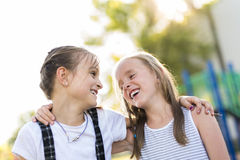 Cheerful school age child play on playground school Stock Photography