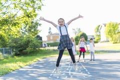 Cheerful school age child play on playground school Stock Image