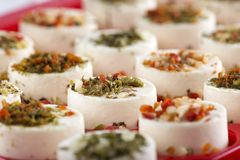 Cheese appetizer with hebs and dried vegetables. Some cheese appetizer with herbs and dried vegetables on top Royalty Free Stock Images