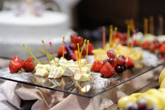 Some cheese and fresh fruits. On a plate Stock Image