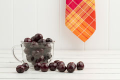 Some cherries in a glass cup Stock Photography