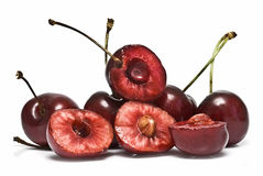 Some cherries and some cut. Royalty Free Stock Image