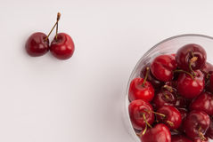 Some cherrys in a glass. On table royalty free stock photos