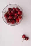 Some cherrys in a glass. On table stock photo