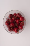 Some cherrys in a glass. On table Royalty Free Stock Photo