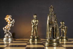 Some Chess Metallic Pieces. On Their Board Royalty Free Stock Photography