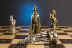 Some Chess Metallic Pieces. On Their Board Stock Photo