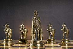 Some Chess Metallic Pieces. On Their Board stock photography
