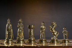 Some Chess Metallic Pieces. On Their Board Royalty Free Stock Image