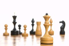 Some chessmen on a chessboard. White background Stock Photos