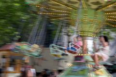 Some children swinging at great speed stock photo