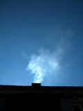Some from chimney. Smoke from chimney against blue sky Stock Image