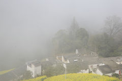Some Chinese village house in thick fog Stock Photography