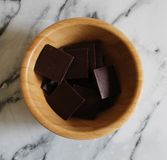 Some chocolate bonbon. On a wooden plate royalty free stock image