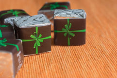 Some chocolates in a paper wrapper. With a bow Royalty Free Stock Images
