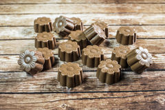 Some chocolates still life. On wooden background Stock Images