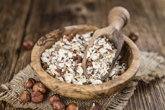 Some chopped Hazelnuts on wooden background Stock Photos