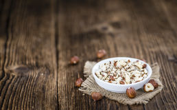 Some chopped Hazelnuts on wooden background Stock Image